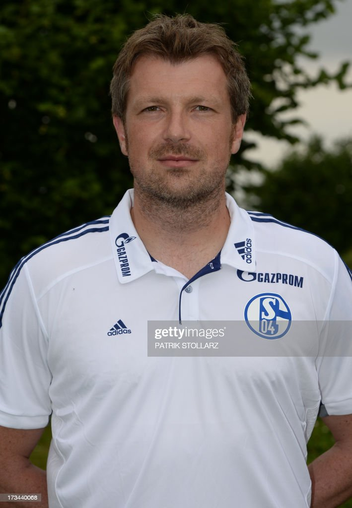 Assistant coach Sven Huebscher poses during a team photo call of German first division Bundesliga football club Schalke 04, on July 10, 2013 at the grounds of the former coal mine 'Consolidation' in Gelsenkirchen, western Germany.