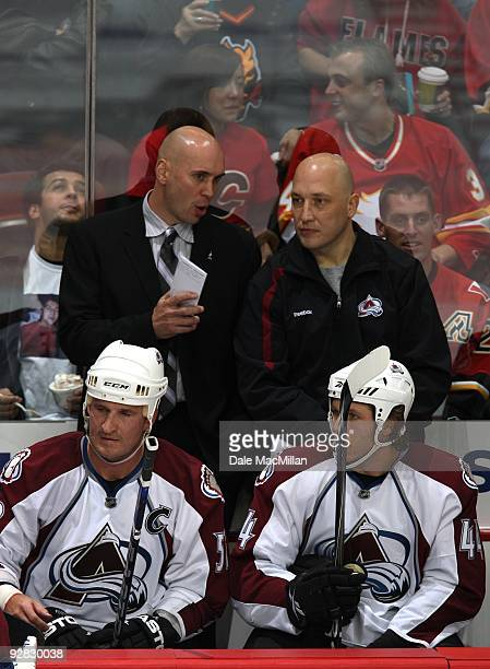 Assistant Coach Sylvain Lefebvre of the Colorado Avalanche looks on from the bench area during their game against the Calgary Flames on October 28...