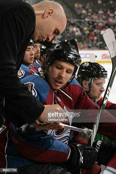 Assistant coach Sylvain Lefebvre shows a play to Ryan Wilson of the Colorado Avalanche skates against the Columbus Blue Jackets at the Pepsi Center...
