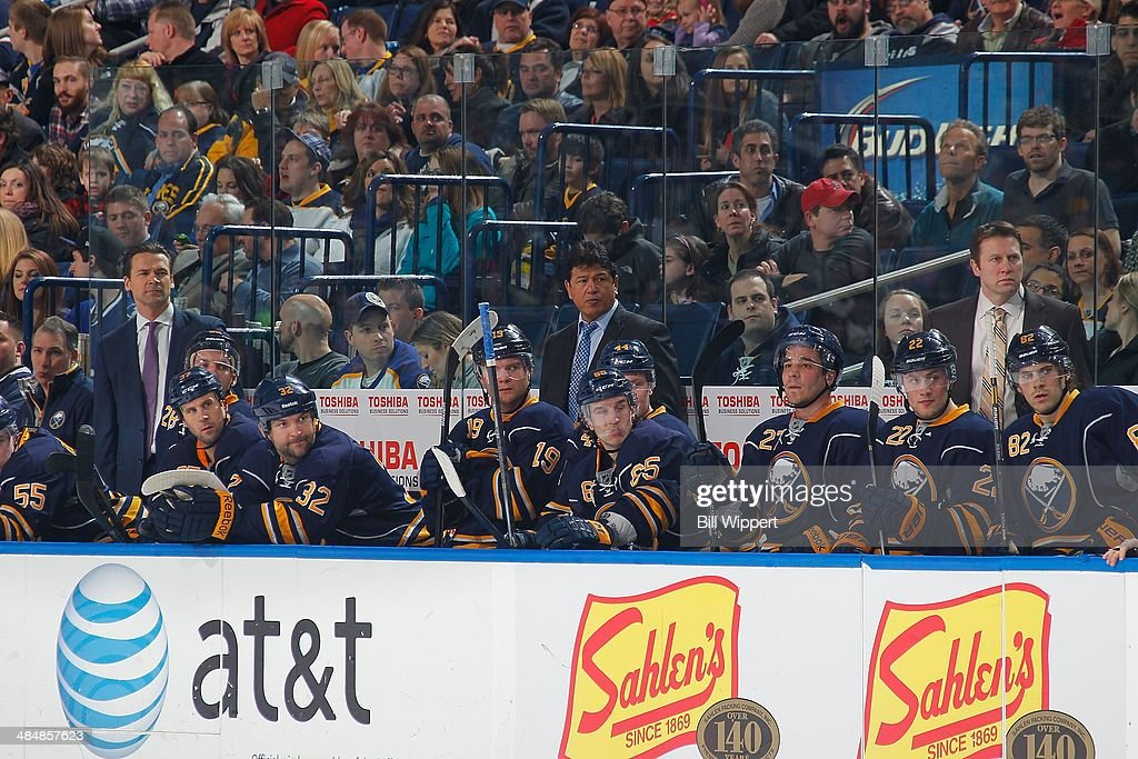 Assistant coach Teppo Numminen head coach Ted Nolan and assistant coach Joe Sacco of the Buffalo Sabres watch the action against the Tampa Bay...