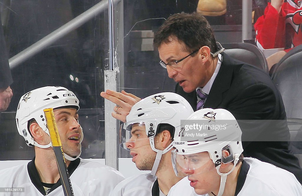 Assistant coach Tony Granado of the Pittsburgh Penguins gives instructions against the New Jersey Devils during the game at the Prudential Center on February 9, 2013 in Newark, New Jersey.