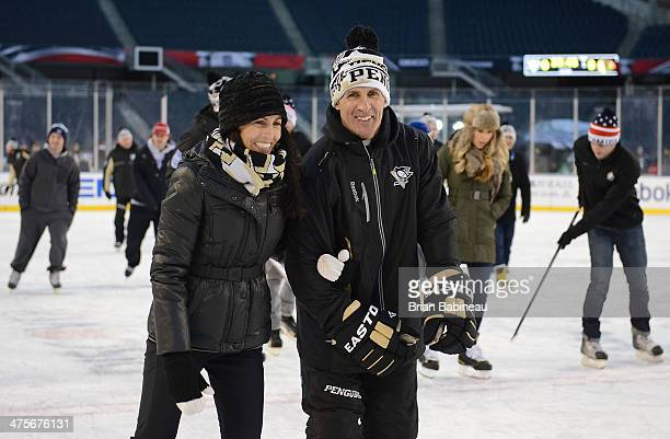 Assistant Coach Tony Granato and wife Linda Granato skate during the 2014 NHL Stadium Series practice day and family skate at Soldier Field on...