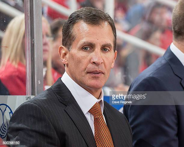 Assistant coach Tony Granato of the Detroit Red Wings watches the action from the bench during an NHL game against the Buffalo Sabres at Joe Louis...
