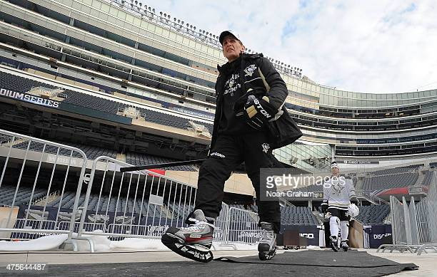 Assistant Coach Tony Granato of the Pittsburgh Penguins makes his way to the ice surface during the 2014 NHL Stadium Series practice day at Soldier...