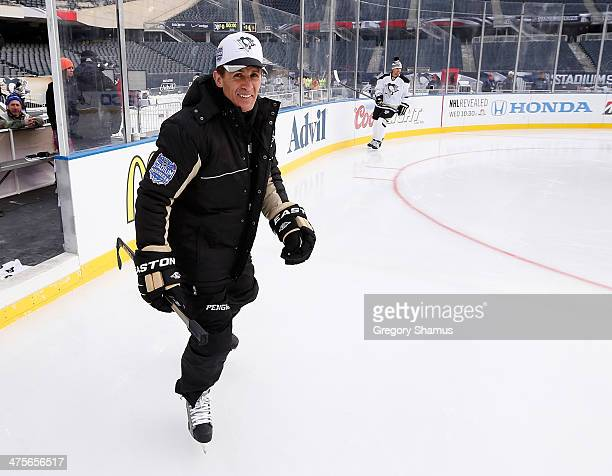 Assistant Coach Tony Granato of the Pittsburgh Penguins skates during the 2014 NHL Stadium Series practice day on February 28 2014 at Soldier Field...
