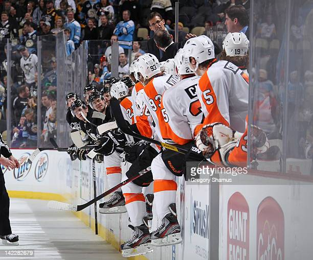 Assistant Coach Tony Granato of the Pittsburgh Penguins yells at Assistant Coach Craig Berube of the Philadelphia Flyers during the game on April 1...