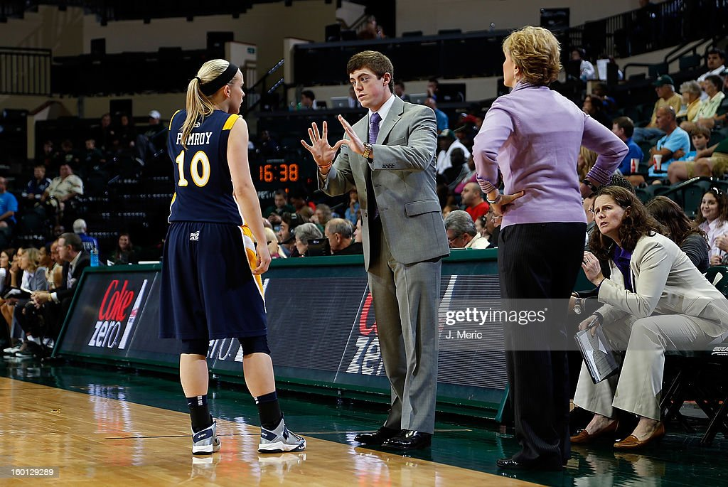 Assistant coach Tyler Summitt talks with Brooklyn Pumroy as head coach Terri Mitchell of the Marquette Golden Eagles looks on during the game against the South Florida Bulls at the Sun Dome on January 26, 2013 in Tampa, Florida.