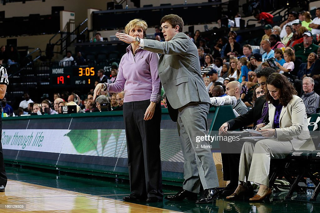 Assistant coach Tyler Summitt talks with head coach Terri Mitchell of the Marquette Golden Eagles during the game against the South Florida Bulls at the Sun Dome on January 26, 2013 in Tampa, Florida.