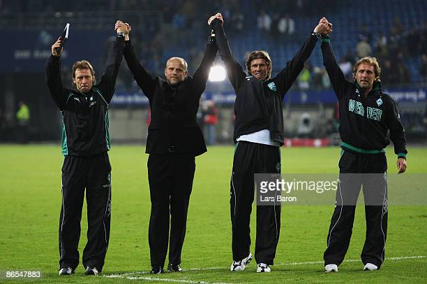 Assistant coach Wolfgang Rolf head coach Thomas Schaaf goalkeeper coach Michael Kraft and assistant coach Matthias Hoenerbach of Bremen during the...