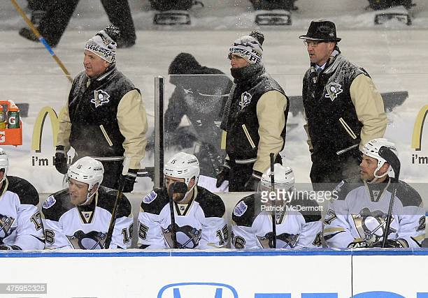 Assistant Coaches Jaques Martin Tony Granato and Head Coach Dan Bylsma of the Pittsburgh Penguins look on in the first period against the Chicago...