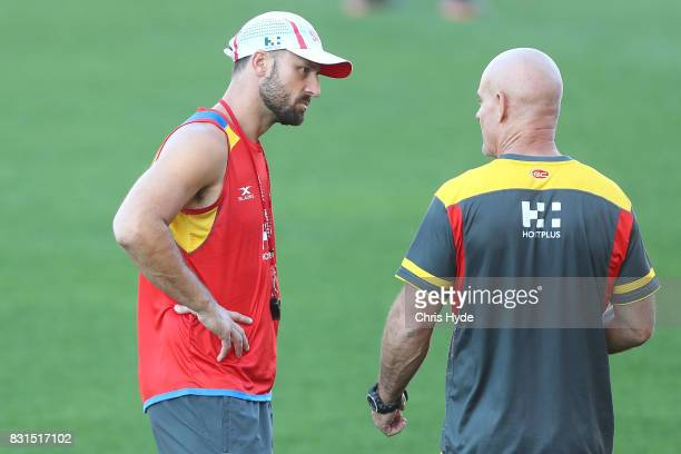 Assistant coaches Nick Malceski and Andy Lovell talk during a Gold Coast Suns AFL training session at Metricon Stadium on August 15 2017 in Gold...