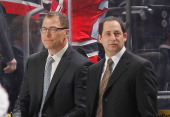 Assistant coachs Scott Stevens and Chris Terreri of the New Jersey Devils look on during pregame warmups prior to the game against the Buffalo Sabres...