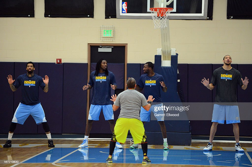 Assistant Coach/Strength and Conditioning Coach Steve Hess directs Wilson Chandler #21, Kenneth Faried #35, Jordan Hamilton #1 and JaVale McGee #34 of the Denver Nuggets through warm-ups before practice prior to Game Two of the Western Conference Quarterfinals against the Golden State Warriors during the 2013 NBA Playoffs on April 22, 2013 at the Pepsi Center in Denver, Colorado.