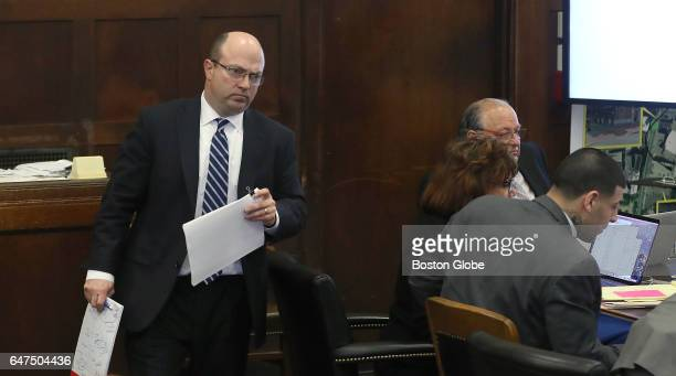 Assistant district attorney Patrick Haggan prepares to question Sergeant Sean McCarthy during the double murder trial of former New England Patriots...