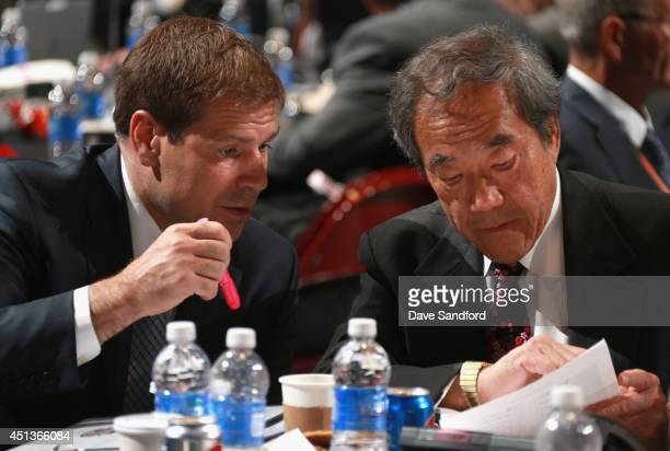 Assistant General Manager and Assistant Coach Doug Weight speaks to team owner Charles Wang of the New York Islanders during the 2014 NHL Entry Draft...