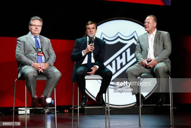 Assistant General Manager Kelly McCrimmon general manager George McPhee and head coach Gerard Gallant of the Vegas Golden Knights speak onstage...
