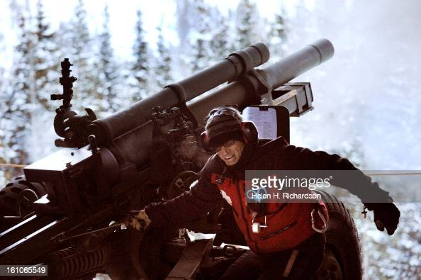 Assistant gunnar Mike Myers pulls the lanyard to fire the howitzer Elite Telluride ski patrollers this year have begun using a WWII Howitzer loaned...