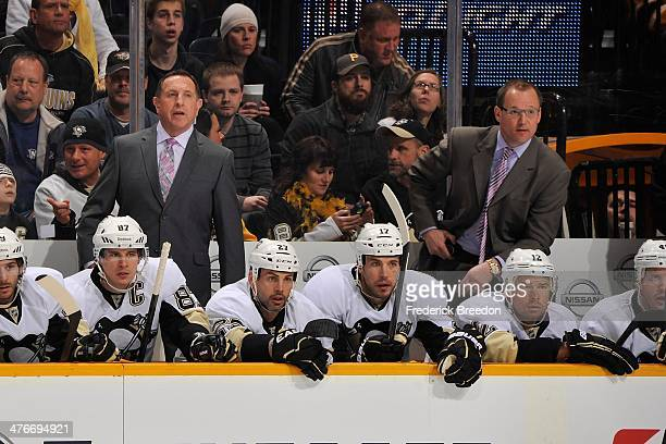 Assistant head coach Jacques Martin and head coach Dan Bylsma of the Pittsburgh Penguins coach during a game against the Nashville Predators at...