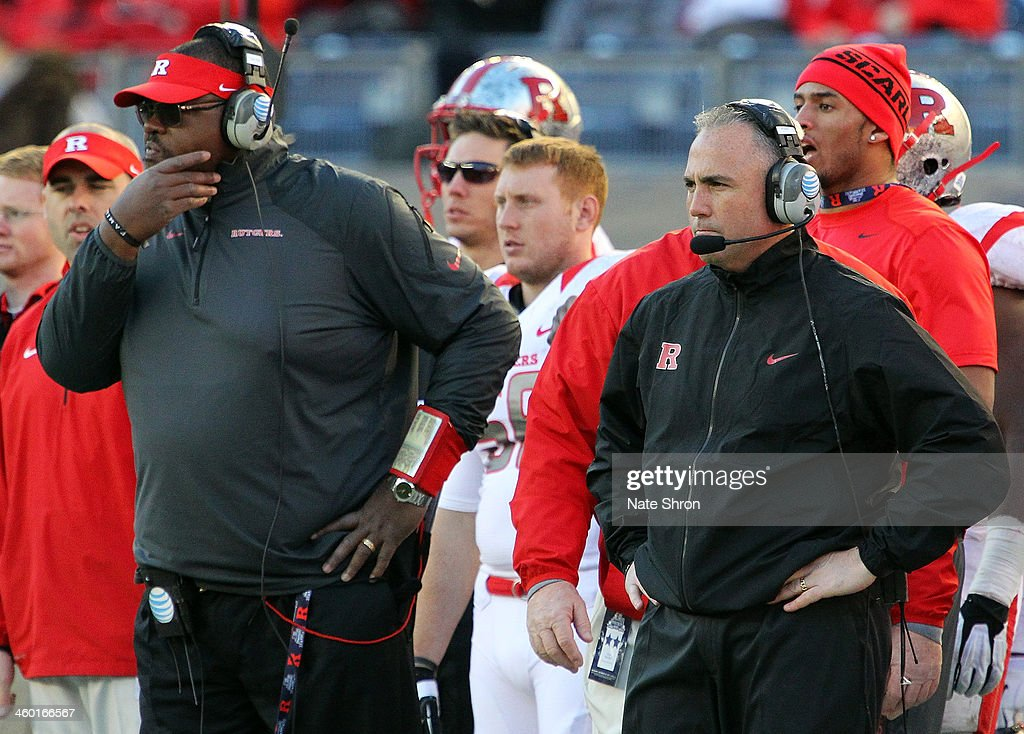 Assistant head coach Norries Wilson (L) and head coach Kyle Flood (R) of the Rutgers Scarlet Knights look on from the sideline during the game against the Notre Dame Fighting Irish at the New Era Pinstripe Bowl at Yankee Stadium on December 28, 2013 in the Bronx Borough of New York City.