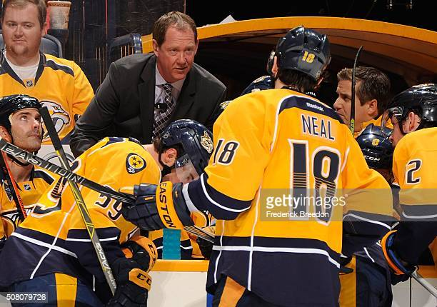 Assistant head coach Phil Housley coaches James Neal duriing a timeout in the third period of a game against the St Louis Blues at Bridgestone Arena...