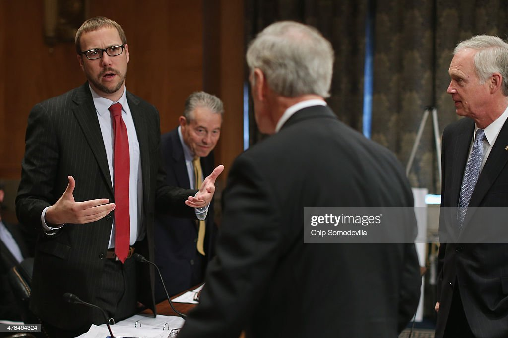 Assistant Homeland Security Secretary Andy Ozment (L) and Office of Personnel Management Inspector General Patrick McFarland (2nd L) talk with Senate Homeland Security and Governmental Affairs Committee Chairman Ron Johnson (R-WI) (R) and ranking member Sen. Tom Carper (D-DE) before a hearing about the recent OPM data breach in the dirksen Senate Office Building on Capitol Hill June 25, 2015 in Washington, DC. OPM Director Kathrine Archuleta said that the recent report that 18 million current, former government employees and people who applied for jobs had their personal data stolen is not confirmed and that only 4.2 million records had been breached.