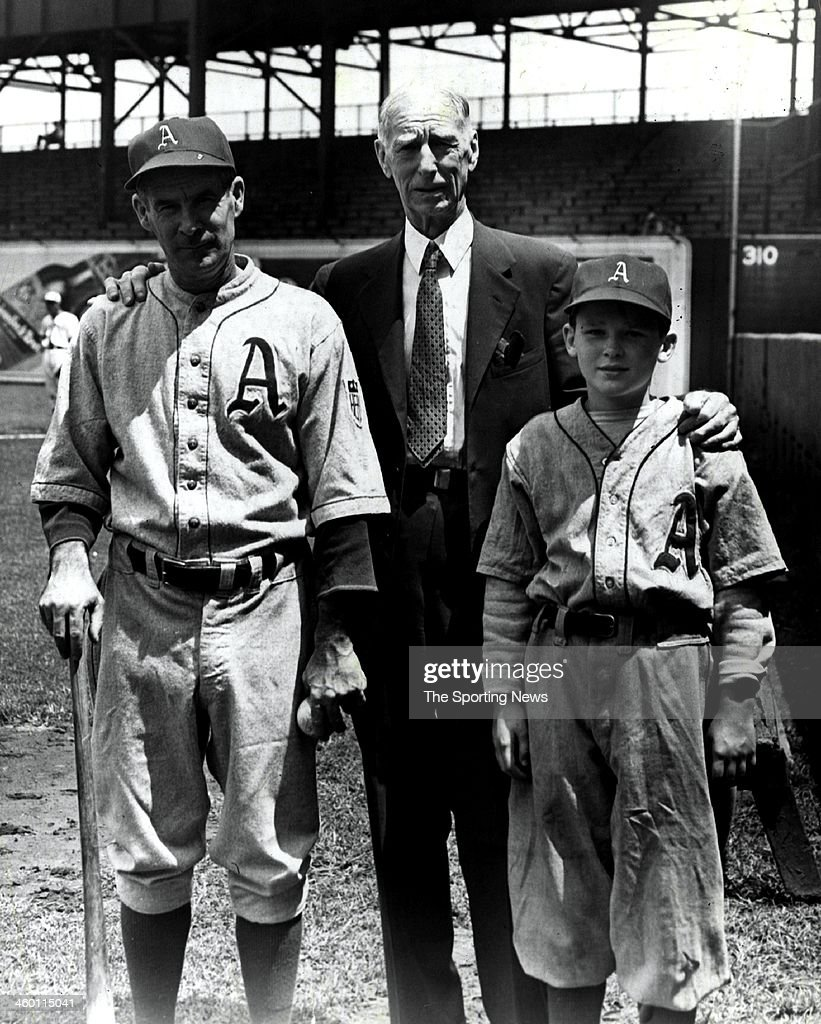 Assistant manager Earl Mack and Manager Connie Mack of the Philadelphia Athletics and Connie Mack III, son of Roy pose for a photo circa 1949.