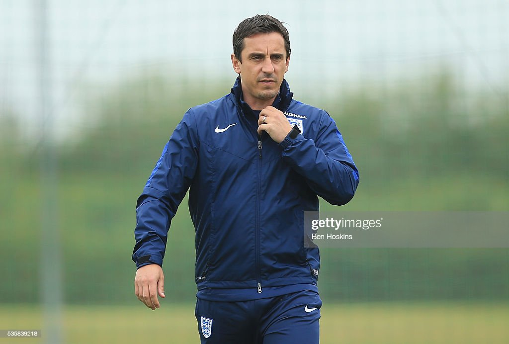 Assistant Manager <a gi-track='captionPersonalityLinkClicked' href=/galleries/search?phrase=Gary+Neville&family=editorial&specificpeople=171409 ng-click='$event.stopPropagation()'>Gary Neville</a> looks on during an England training session at St Georges Park on May 30, 2016 in Burton on Trent, England.