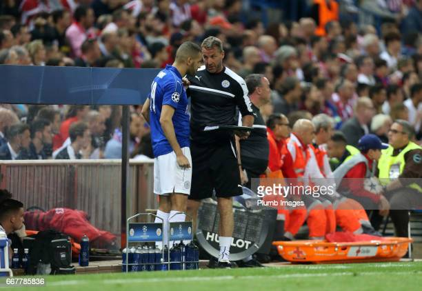 Assistant manager Mike Stowell of Leicester City gives instructions Islam Slimani of Leicester City during the Champions League quarter final first...