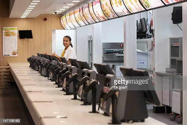Assistant manager Rachel Lucien stands at the checkouts in the world's largest McDonald's restaurant which is their flagship outlet in the Olympic...
