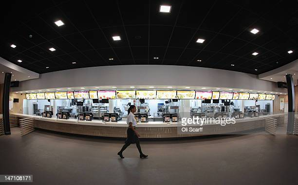 Assistant manager Rachel Lucien walks past the checkouts in the world's largest McDonald's restaurant which is their flagship outlet in the Olympic...