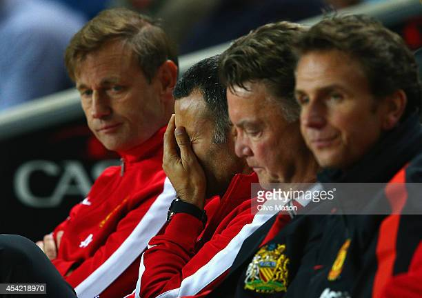 Assistant manager Ryan Giggs looks dejected with manager Louis van Gaal of Manchester United during the Capital One Cup Second Round match between MK...