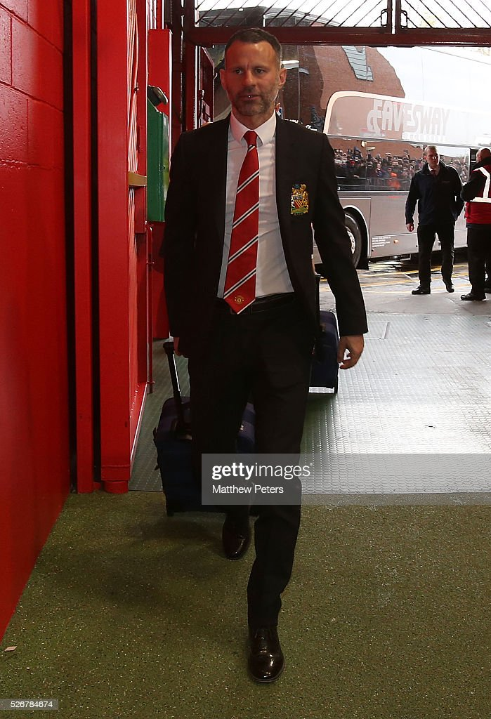 Assistant Manager <a gi-track='captionPersonalityLinkClicked' href=/galleries/search?phrase=Ryan+Giggs&family=editorial&specificpeople=201666 ng-click='$event.stopPropagation()'>Ryan Giggs</a> of Manchester United arrives at Old Trafford ahead of the Barclays Premier League match between Manchester United and Leicester City at Old Trafford on May 1, 2016 in Manchester, England.