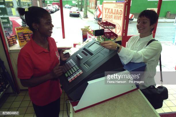 Assistant manageress of a 711 store in Willesden Esther Ogo tests the new National Lottery terminal one of 10000 installed across Britain while...