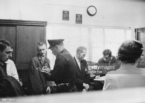 Assistant Managers At Woolworth Cherry Creek Describe Holdup Patrolman Jerry Gardner in uniform takes information from Ken Idol while Detective Sgt...