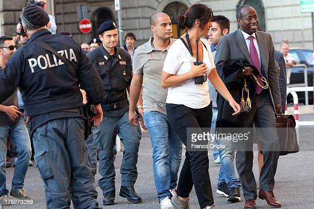 Assistant of Silvio Berlusconi's lawyer Franco Coppi leaves the Justice palace escorted by police after the verdict of the 'Corte di Cassazione'...