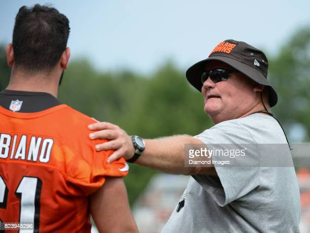 Assistant offensive line coach Mark Hutson of the Cleveland Browns gives instruction to offensive lineman Anthony Fabiano during a training camp...