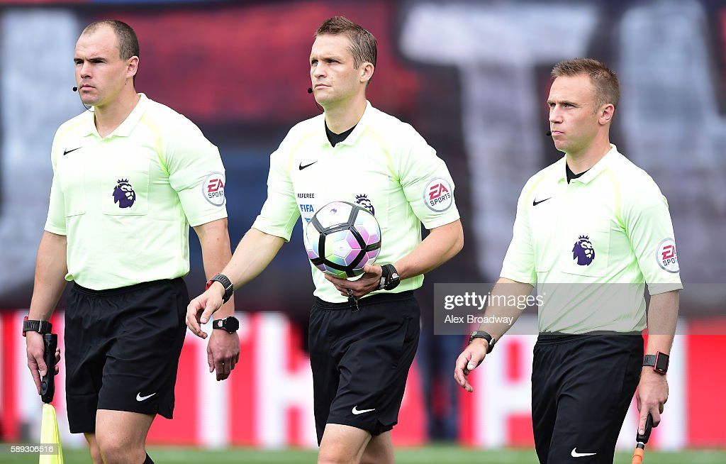 Assistant Referee Adrian Holmes Referee Craig Pawson and Assistant Referee Harry Lennard walk onto the pitch prior to the Premier League match...