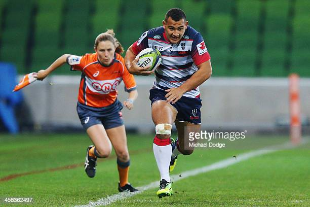 Assistant Referee Amy Perrett the first ever women referee in Super Rugby history follows Jonah Placid of the Rebels during the round 15 Super Rugby...