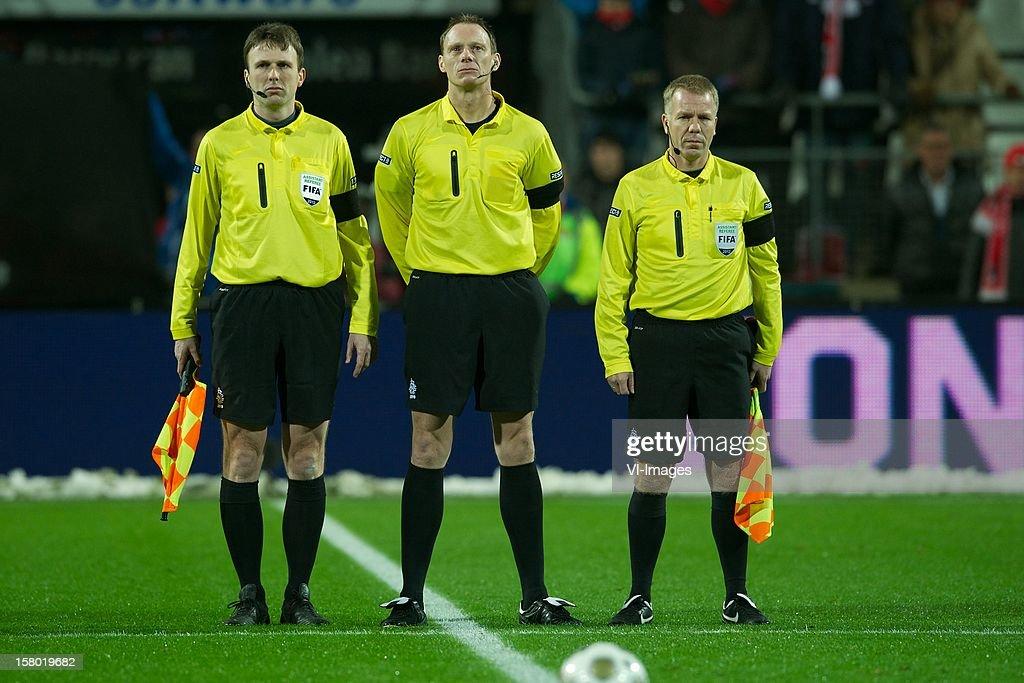 assistant referee Bas van Dongen, referee Ed Janssen, assistant referee Wilco Lobbert during the Dutch Eredivisie match between AZ Alkmaar and Willem II at the AFAS Stadium on December 08, 2012 in Alkmaar, The Netherlands.