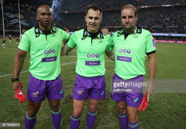 Assistant Referee Egon Seconds of South Africa with Referee Marius van der Westhuizen of South Africa and Assistant Referee Stuart Berry of South...