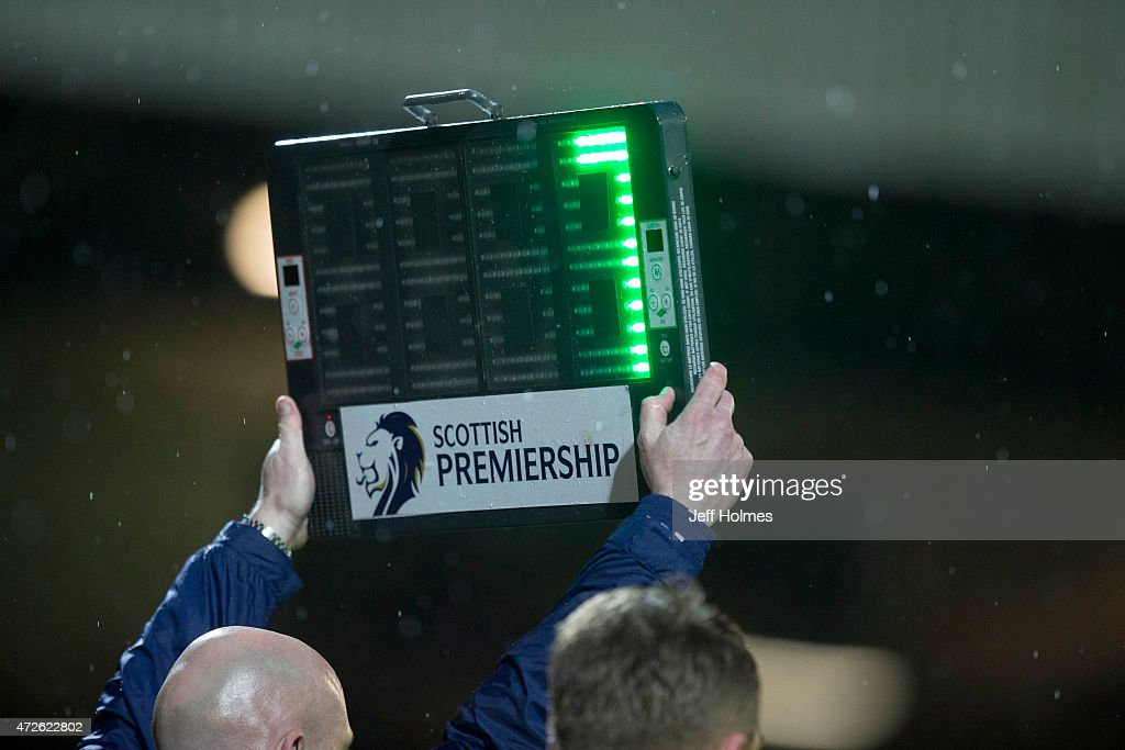 Assistant Referee holds up the Substitues board during the Scottish premiership match between Motherwell and Kilmarnock at Fir Park on May 8 2015 in...