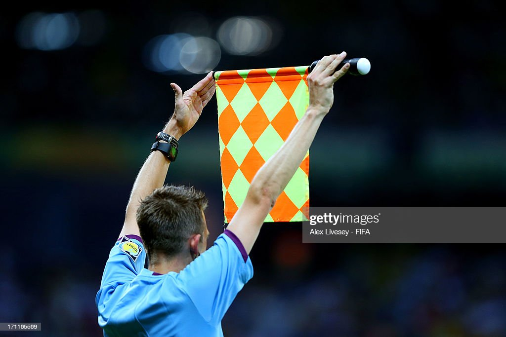Assistant referee indicates there will be a substitution during the FIFA Confederations Cup Brazil 2013 Group A match between Japan and Mexico at Estadio Mineirao on June 22, 2013 in Belo Horizonte, Brazil.