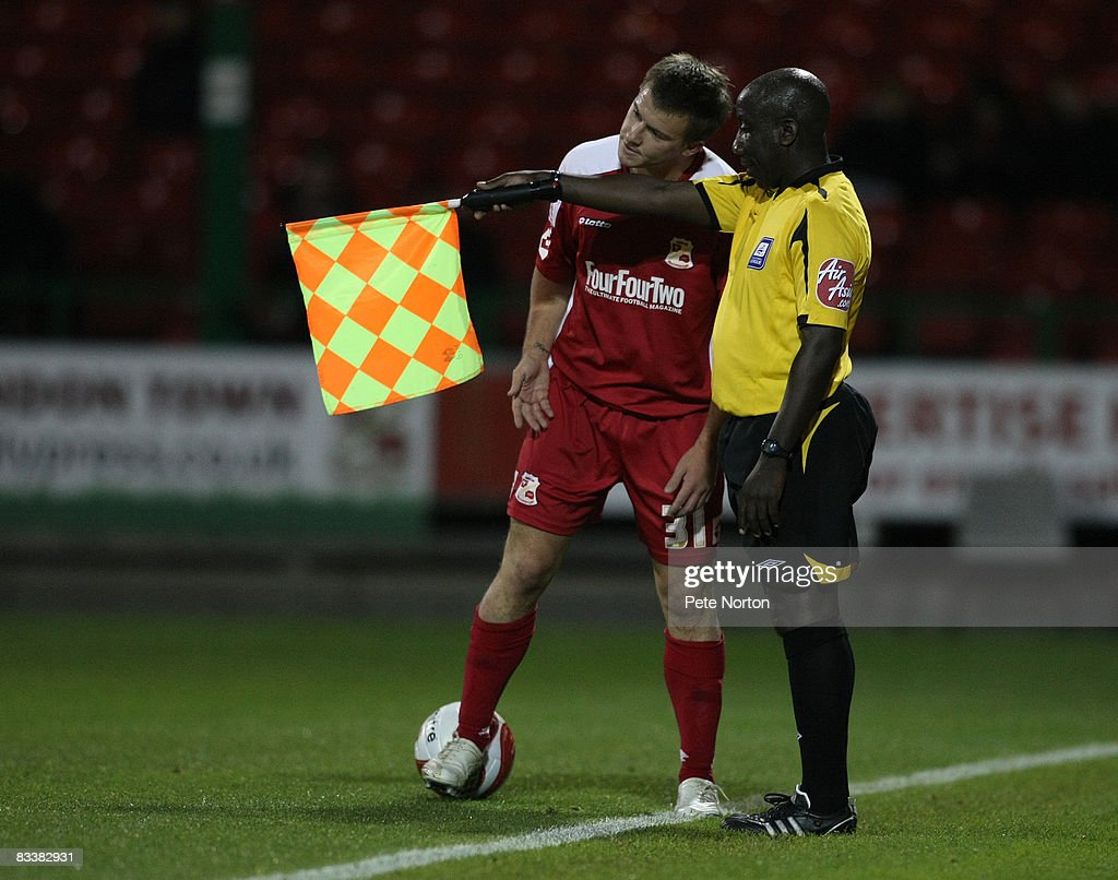 Assistant referee Matt Foley flags for offside against Simon Cox of Swindon Town who questions the decision during the Coca Cola League One Match between Swindon Town and Northampton Town at the County Ground on October 21, 2008 in Swindon, England.