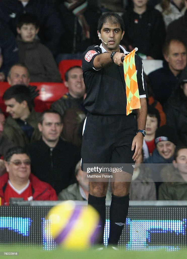 Assistant referee Mo Matadar flags for offside during the Barclays FA Premier League match between Manchester United and Fulham at Old Trafford on...