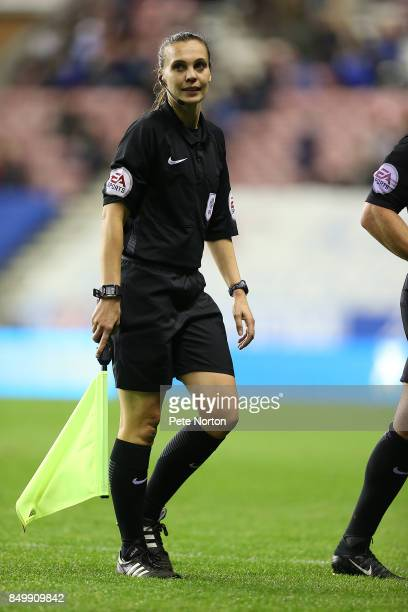 Assistant Referee Natalie Aspinall walks from the pitch at half time during the Sky Bet League One match between Wigan Athletic and Northampton Town...