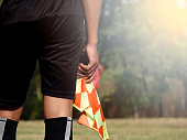 Assistant referee or Lineman of football or soccer holding flag