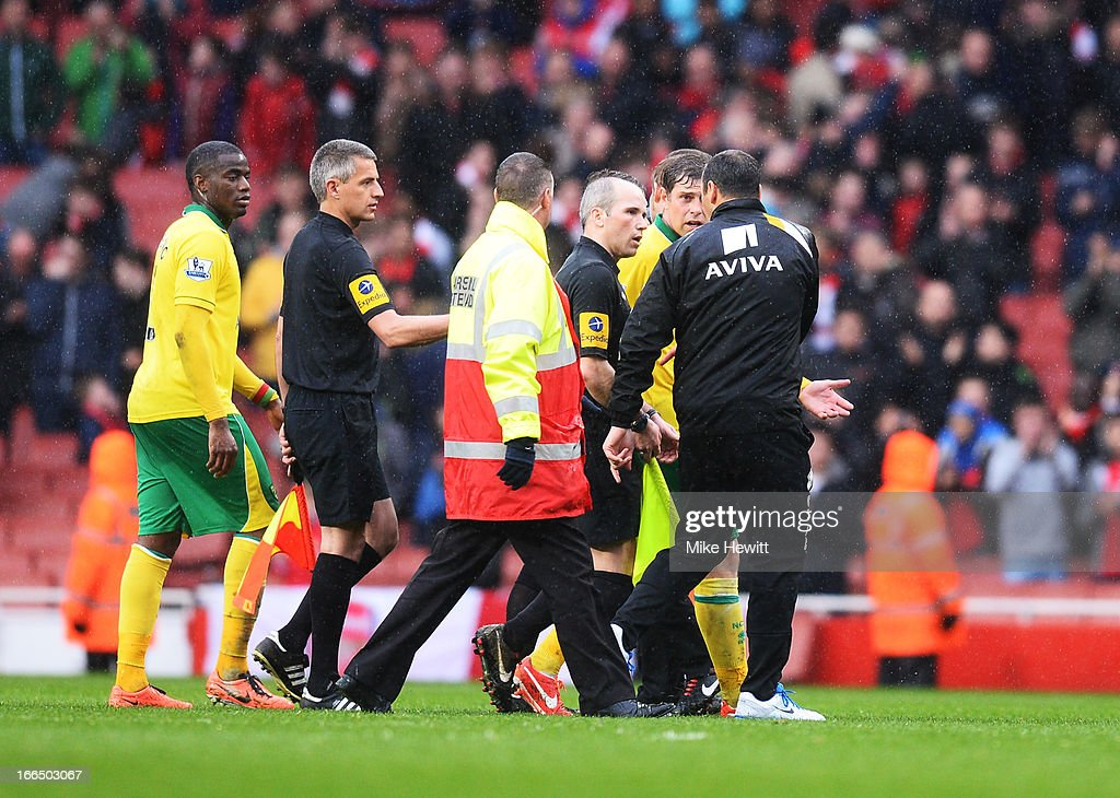 Assistant referee Richard West walks off the pitch after the Barclays Premier League match between Arsenal and Norwich City at Emirates Stadium on April 13, 2013 in London, England.