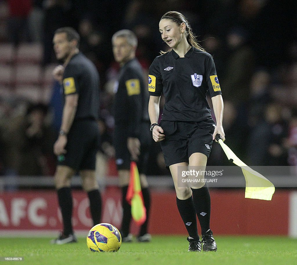 "Assistant referee Sian Massey collects the ball during the English Premier League football match between Sunderland and Swansea City at The Stadium of Light in Sunderland, north-east England on January 29, 2013. The game finished 0-0. AFP PHOTO/GRAHAM STUART USE. No use with unauthorized audio, video, data, fixture lists, club/league logos or ""live"" services. Online in-match use limited to 45 images, no video emulation. No use in betting, games or single club/league/player publications"