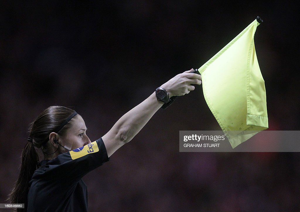 """Assistant referee Sian Massey gestures during the English Premier League football match between Sunderland and Swansea City at The Stadium of Light in Sunderland, north-east England on January 29, 2013. The game finished 0-0. USE. No use with unauthorized audio, video, data, fixture lists, club/league logos or """"live"""" services. Online in-match use limited to 45 images, no video emulation. No use in betting, games or single club/league/player publications"""