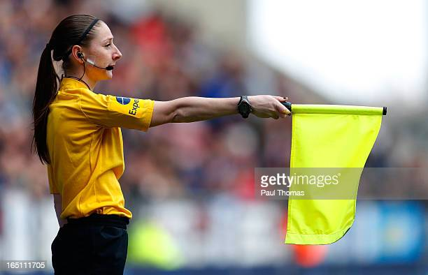 Assistant Referee Sian Massey in action during the Premier League match between Wigan Athletic and Norwich City at the DW Stadium on March 30 2013 in...